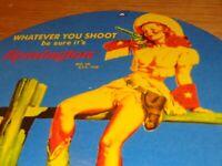 """VINTAGE 1958 REMINGTON FEMALE WOMAN SHOOTS 11 3/4"""" PORCELAIN METAL GAS OIL SIGN!"""