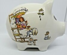 Piggy Bank White Ceramic with girl on one side and boy on the other side