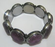 Lovely elasticated dark tone silver plastic and purple sparkly circles