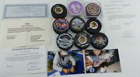CHICAGO BLACKHAWKS SIGNED PUCKS LOT OF 9 WITH SOME COA 112463-1 LOC. L-1