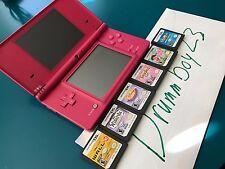 Pink Nintendo DSi with 6 games! Disney Wall-e wizard penguin tangled Dora!