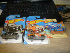 3 HOT WHEELS FORD ESCORTS. CARDED.