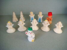 Eleven vintage waxed Christmas – themed candles