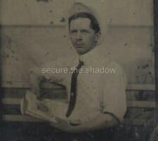 TINTYPE: YOUNG MAN on BENCH w MAGAZINE FINGERPRINTS & HALO EFFECT in BACKGROUND
