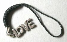 word LOVE phone charm silver tone