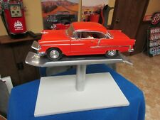 1/18th scale DIE CAST ALUMINUM DISPLAY LIFT/1955 CHEVY/MUSCLE MACHINES