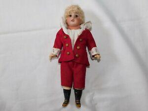 Frühe Puppe mit rotem Anzug S und H Germany !