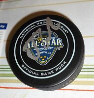 JOHNNY GAUDREAU -- CALGARY FLAMES -- SIGNED PUCK -- PSA CERTIFIED