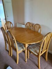 Large oak extending dining table and 6 chairs