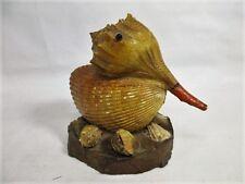 Vintage folk art bird made from sea shells