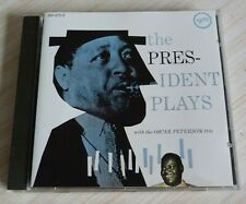 CD ALBUM THE PRESIDENT PLAYS WITH THE OSCAR PETERSON TRIO 13 TITRES WEST GERMANY