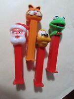 Lot of 4 PEZ dispensers - Kermit the frog, Santa Claus, Garfield the Cat , Pluto