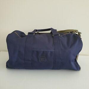 Herschel Supply Co Unisex Novel 600D Duffle Overnight Bag Navy Blue/Green Trim