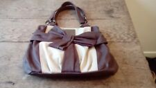 Brown Suzy Smith Handbag With Bow Design To The Front. Red Interior.