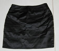 Women size 6-8 black pleated panel short skirt made by BLUEJUICE - Satiny