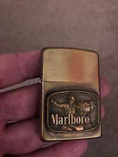 1976 Vintage brass Zippo lighter - Marlboro Cowboy w/ lasso rope on horse - rare
