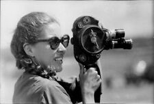 Michele Ray Is Wearing A Sunglass And Holding A camera To Shoot A Picture. - 8x1