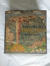 Peek Frean's 'Day by Day Assorted Biscuits' tin.