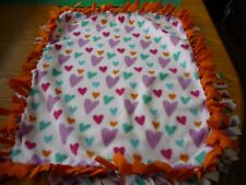 Handmade fleece tie blanket of multi-color hearts for a small pet