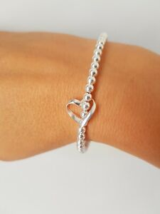 Sterling Silver 4mm Beaded Stretch Bracelet with a 925 Floating Heart Charm