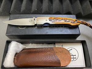 WILLIAM HENRY KNIFE TITANIUM FRAME, AMBER BONE HANDLE, TITANIUM BOLSTER