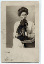 Woman and dog, Cocker Spaniel, Moberly, Missouri, 1908 real photo postcard Rppc