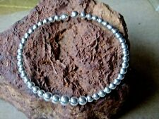 SOLID STERLING SILVER ADJUSTABLE BRACELETwithGRADUATING BALL SHAPED BEADS £35.95