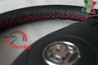 BLACK LEATHER STEERING WHEEL COVER FOR CORSA D 06+ WITH RED DOUBLE STITCHING