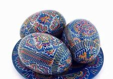 3 wooden Easter eggs hand painted Ukrainian Pysanka on the plate from Ukraine