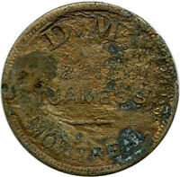 D. M. 2217 St. James St. Montreal, Canada Good For 5¢ Trade Token