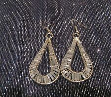 Very pretty silver tone metal earrings Teardrop design with small grey beads