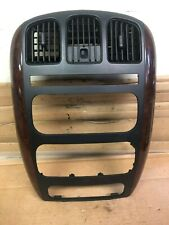 02 CHRYSLER TOWN COUNTRY RADIO CLIMATE CONTROL BEZEL. WOODGRAIN. WITH VENTS