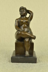 Fernando Botero sculpture of nude woman sitting finished in a Brown patin Statue