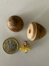 """""""Smallest doll in the world"""" in a floral decorated wooden egg circa 1920's"""