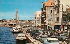 Curacao docked boats old cars Postcard