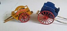 Britain's lead wagon/cart and a milk cart by Charbens.
