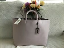 NWT. Coach Glovetanned Leather Rogue Tote Floral Bow Interior Ice Pink 28430