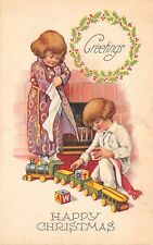 Christmas~Children in Robe~Sleeper Pajamas~Dig Thru Stocking~Toy Train~c1916 PC