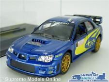 SUBARU IMPREZA WRC CAR MODEL 1:36 SIZE RALLY BLUE + CASE SOLBERG KINSMART T3