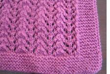 Easy to knit Lacy baby blanket pattern in DK