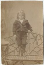 1890s Well-Dressed Boy on Fantastic Rustic Wood Bench Photo
