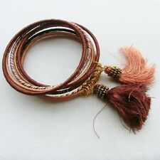 Lotto bracciali bangle indiani in filo marrone con nappine