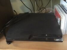 Sony Playstation 3: 160 Gb slim black console + controller and four games