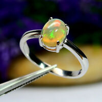 NATURAL 7 X 9 mm. OVAL WHITE RAINBOW OPAL RING 925 STERLING SILVER WHITE GOLD