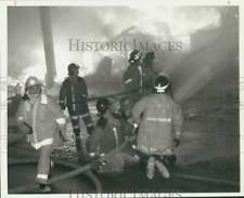 1990 Press Photo Firefighter Robert Cornue at Tully Building Supply Fire