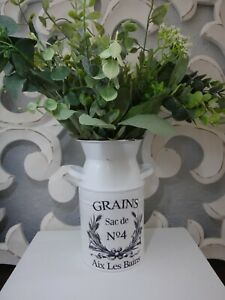 Farmhouse style floral greenery arrangement in metal milk can style container