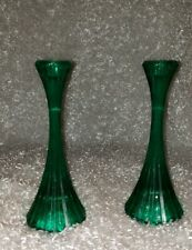 A traditional round base candlesticks in Dark green glass with rubbing all aroun