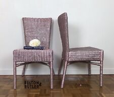 Set of Two Metallic Rose Gold Wicker Chairs.