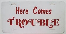 1990's HERE COMES TROUBLE BOOSTER License Plate