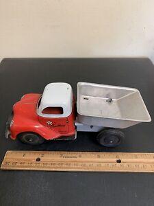 A Walt Reach Toy by Courtland- Wind Up Dump Truck- Motor Works